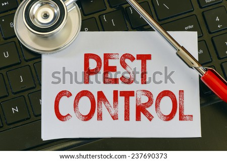 Pest control sign and stethoscope. Pest control sign and stethoscope. Medicine concept on computer keyboards - stock photo