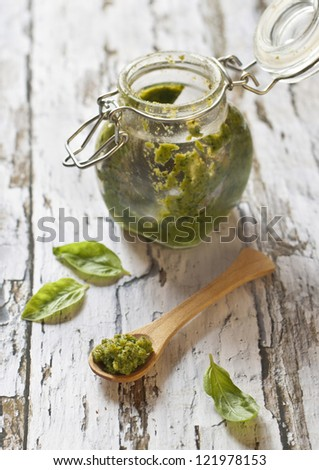 pesto genovese on wooden table - stock photo