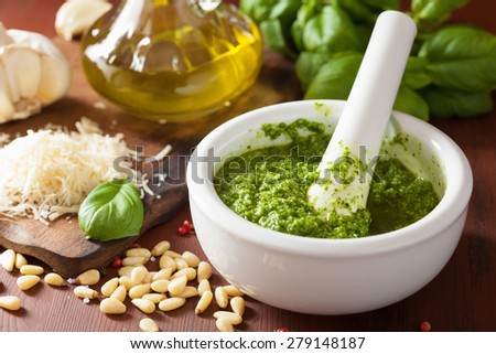 pesto sauce and ingredients over wooden rustic background - stock photo