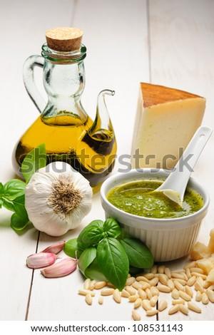 Pesto sauce, typical italian pesto with basil, olive oil parmesan reggiano and pine nuts. - stock photo