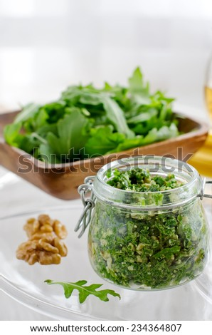 Pesto with ruccola and walnut in a bowl - stock photo