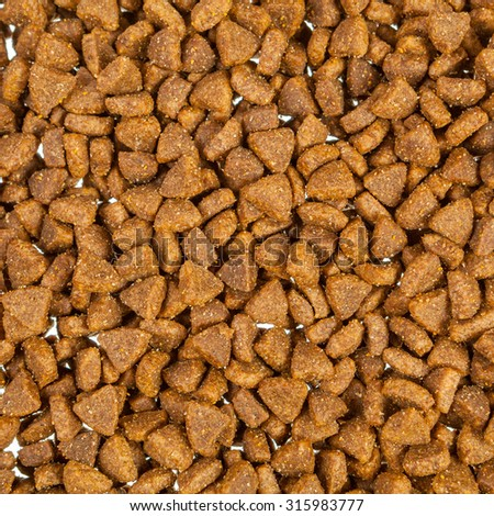 Pet food pieces background - stock photo