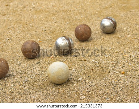 Petanque balls different on the ground. - stock photo