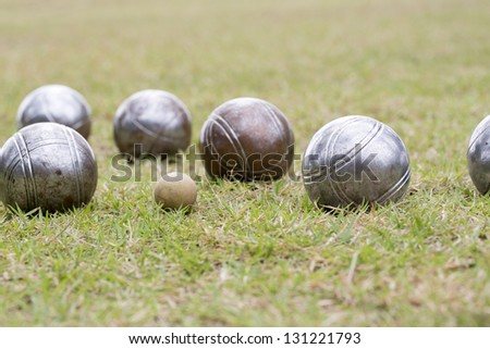 Petanque balls on the ground - stock photo