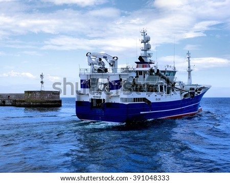 Peterhead, Scotland, 19th of June 2012, Fishing Trawler departing harbor for fishing grounds. - stock photo