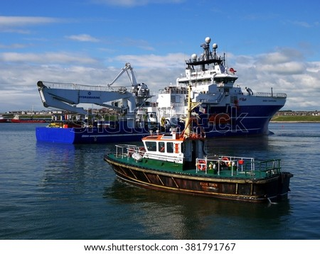 Peterhead, Scotland, 16th of June 2009, Offshore Diving Vessel in port under pilot command during maneuvers. - stock photo