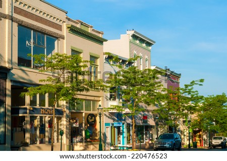 "PETOSKEY, MI - JUNE 27, 2014: Petoskey's quaint and charming ""Gaslight"" business district makes it a popular draw for vacationers heading to Michigan's northern Lake Michigan resorts. - stock photo"