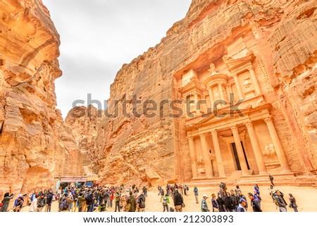 PETRA, JORDAN - DECEMBER 30: The Treasury in the ancient Edomite city of Petra, Jordan on December 30, 2013. It is known as Al Khazneh. - stock photo