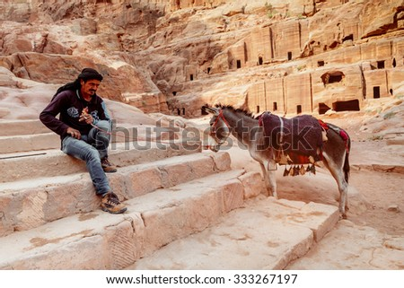 PETRA, JORDAN - SEP 12:Jordanian Arab Bedouin man at the Petra. Bedouin, the inhabitants the the region around Petra in the ancient site in Jordan. - stock photo
