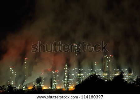 Petrochemical industry night view, a contamination of the ozone - stock photo