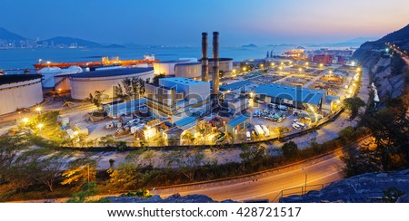 petrochemical industry on sunset , hong kong coal power station and oil tank - stock photo