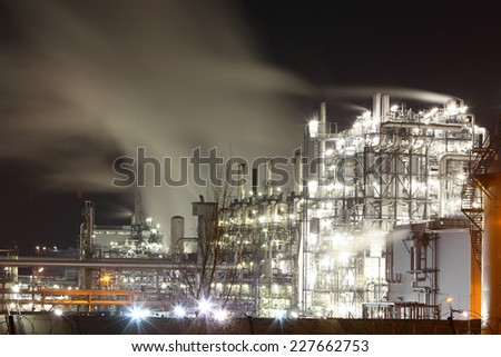 Petrochemical oil and gas refinery plant in night - stock photo