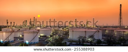 Petrochemical oil and gas refinery plant in sunset with panorama view - stock photo