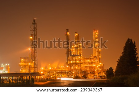 Petrochemical oil refinery plant at night time  - stock photo