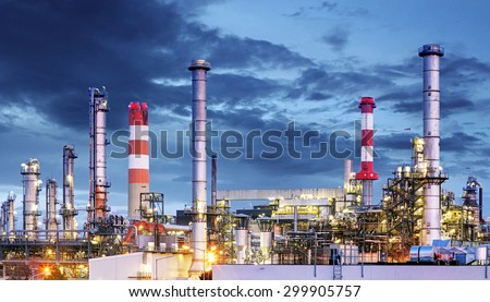 Petrochemical plant at night, oil and gas industrial - stock photo