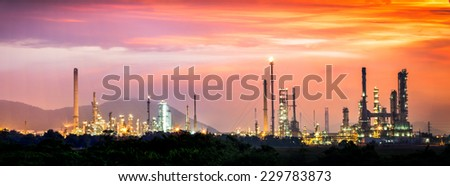 Petrochemical plant at panorama view in sunrise - stock photo