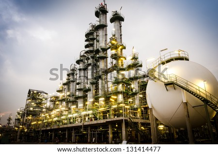 petrochemical plant column tower at twilight - stock photo