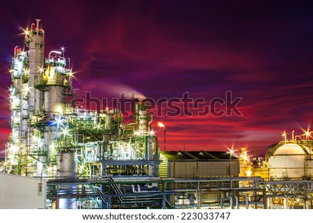 petrochemical plant in sun set - stock photo