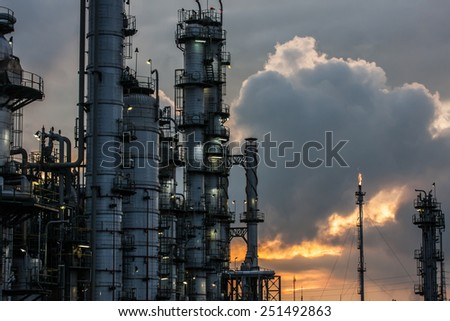 petrochemical plant in sunset - stock photo