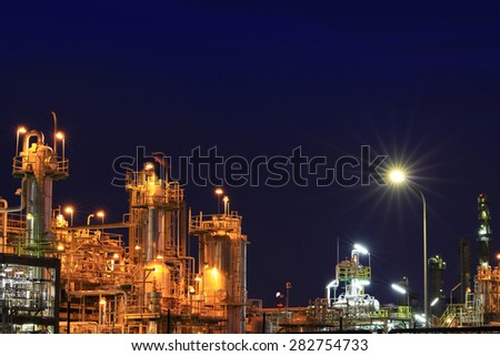 Petrochemical plant in twilight background - stock photo