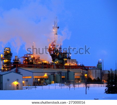 Petrochemical refinery at dusk in late winter (Edmonton, Alberta) - stock photo