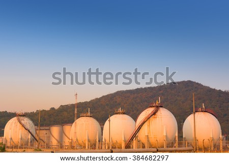 Petrochemical spherical tank on twilight. - stock photo