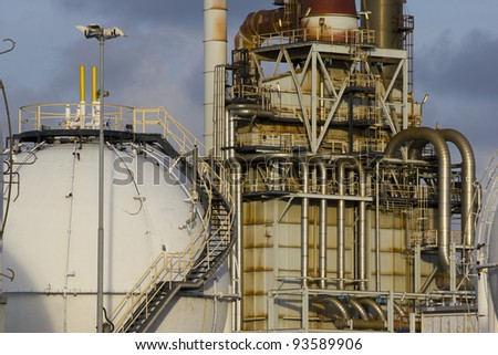 Petrochemical-tanks and a large oil-refinery-plant - stock photo
