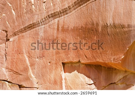 Petroglyph or rock carvings of Indians (Native Americans) on a canyon wall in Utah, USA - stock photo