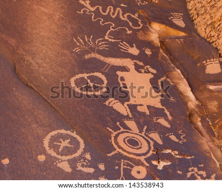 Petroglyphs carved in rocks by the Navajo and Hopi native American tribes. - stock photo