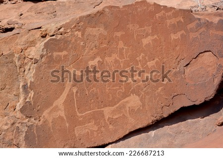 Petroglyphs in Twyfelfontein (Afrikaans: uncertain spring), officially known (Damara/Nama: jumping waterhole), is a site of ancient rock engravings in the Kunene Region of north-western Namibia. - stock photo
