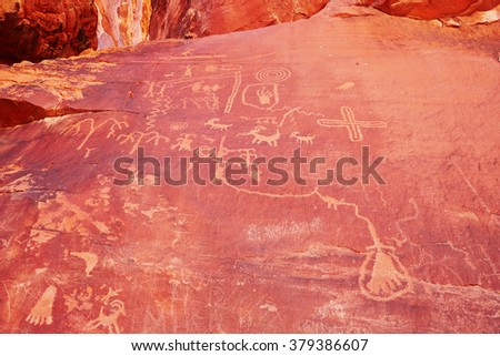Petroglyphs on a rock in the Valley of the Fire in Nevada, USA - stock photo