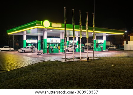 Petrol and gas modern station at night with glowing lights - stock photo