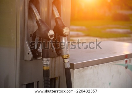 Petrol and gasoline nozzles at the fuel station - stock photo