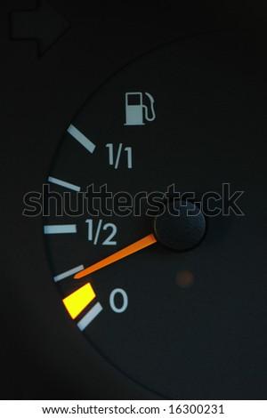 Petrol meter showing low petrol level - stock photo