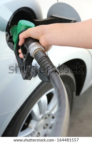 Petrol or gasoline being pumped into a motor vehicle car - stock photo