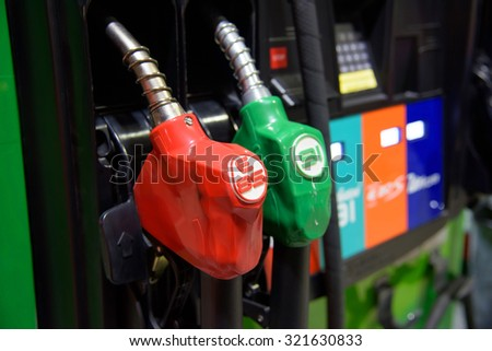 Petrol pump of gas station in Thailand - stock photo