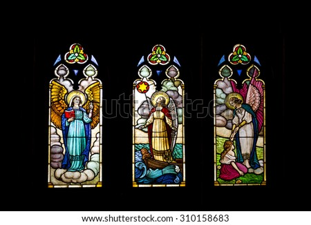 PETROPOLIS, RIO DE JANEIRO / BRAZIL - August 20, 2015: stained glass - interior of São Pedro de Alcântara Cathedral - portraying Faith, Hope and Charity - precepts - Christianity - Imperial City - stock photo