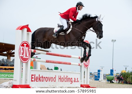 PEZINOK, SLOVAKIA - JULY 25: Maros Kuchar on horse Dorado in action at Slovak Republic Championship in Horse-jumping 2010, Slovakia, July 25, 2010 in Slovakia - stock photo