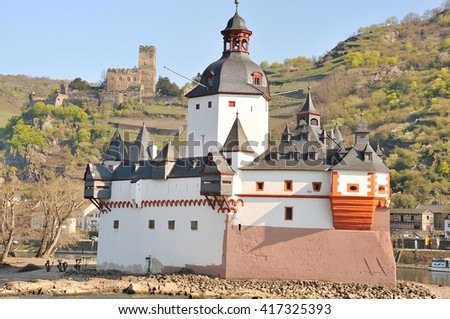 Pfalzgrafenstein Castle in the Rhine River at Kaub  with Gutenfels Castle in the background, Germany - stock photo