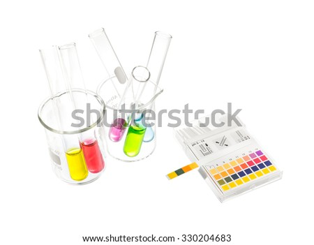 pH paper indicators and tube solution with pH values - stock photo