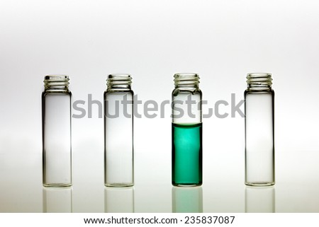 pH test and tree empty flasks  - stock photo