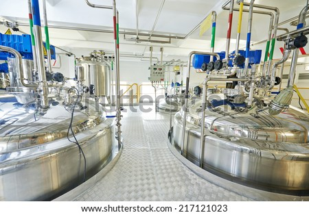 pharmaceutical factory equipment mixing tank on production line in pharmacy industry manufacture factory - stock photo