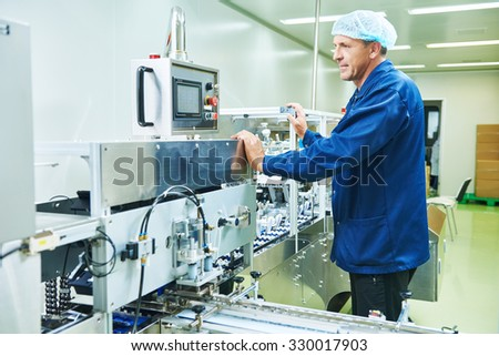 pharmaceutical factory man worker operating production line at pharmacy industry manufacture factory - stock photo