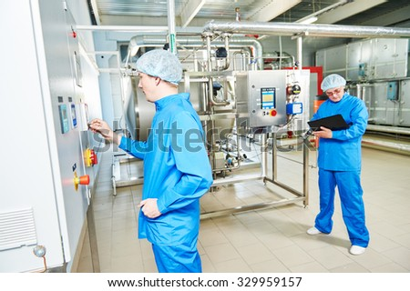 pharmaceutical factory service engineers in water preparation room operating equipment at pharmacy industry manufacture factory  - stock photo