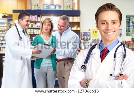 Pharmacist and a senior couple in pharmacy. - stock photo