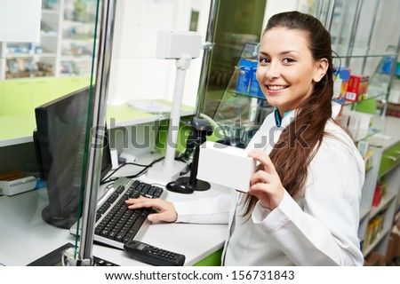 pharmacist chemist woman working in pharmacy drugstore with tablet computer - stock photo