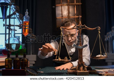 Pharmacist in a drugstore weighs powder - stock photo
