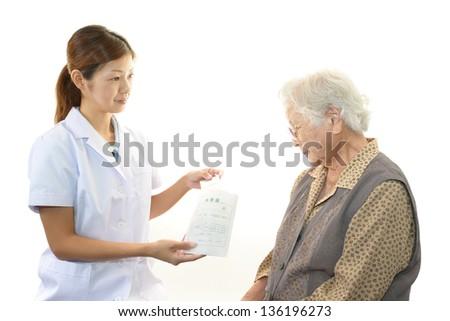 Pharmacist with senior woman - stock photo