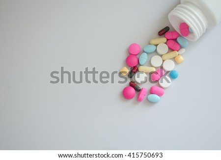 Pharmacy background on a wood table.Pills. Medicine and healthy. Close up of capsules. Different kind of medicines - stock photo