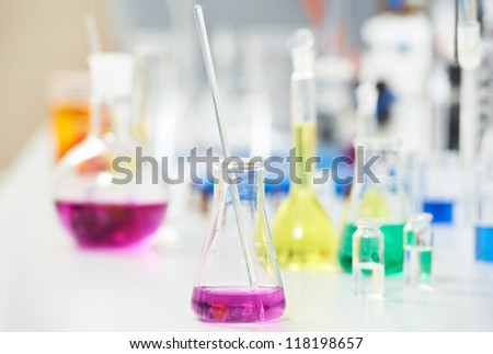 Pharmacy Laboratory and chemistry theme. Test glass flask with liquid solution in research - stock photo